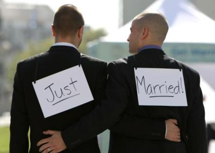 81601297-same-sex-couple-ariel-owens-and-his-spouse-joseph-barham.jpg.CROP.promo-mediumlarge